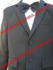 Продам школьный костюм на первоклассника ученика средних классов