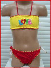 Продаю  детский купальник с жёлтым топиком для девочки!